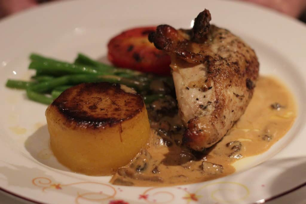 Roasted Thyme Marinated Chicken Breast with Fondant Potato, Haricot Vert and a Morel Mushroom-Cognac Sour Cream Sauce Rapunzel's Royal Table Seasons Menu Transatlantic Cruise Disney Magic